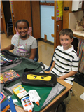 Desks were filled with supplies that were sorted and organized on the first day of school.