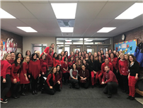 JFK Staff Go 'Red' to Support Women