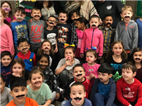 May Moore's Mustaches Make for Diligent Readers